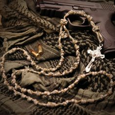 """Combat Paracord Rosary  """"""""""""""""There is over 15 feet of military grade 550 paracord used to make this Rosary & it takes considerable time to knot but the result is well worth it.    If you're looking for something strong, waterproof, unbreakable in the field, that can be stuffed in a pack or pocket or even warn around the neck, this is a perfect choice."""