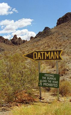 """Route 66 - Sign points east to Oatman, Arizona on Rt. 66. A trip through some rugged mountains is required. """"The Fine Art Photography of Frank Romeo."""""""