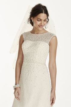 Pearl beaded cap sleeve wedding gown by Jewel at @DavidsBridal