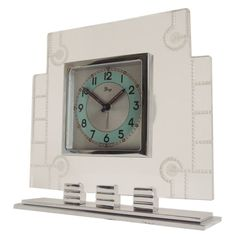 c1939 French Art Deco Chrome, Aluminium and Lucite Mechanical Alarm Clock by Dep | From a unique collection of antique and modern clocks at https://www.1stdibs.com/furniture/decorative-objects/clocks/