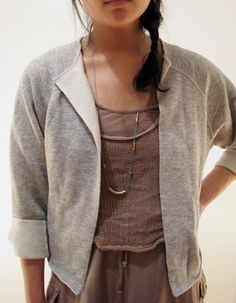 DIY Sweatshirt Cardigan. After a brief glance at the linked website, I couldn't find this cardy. Should be pretty easy to duplicate though.