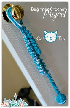 Crochet cat/dog toy{I'll use it to hang on back door so my DOG can signal that he needs out} to hang from doorknob. The twirls hang down and spring and at the bottom is a ball {I'm using a BELL}