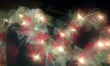Garland made out of Christmas lights and colored tool. Just tie to the lights. So beautiful!