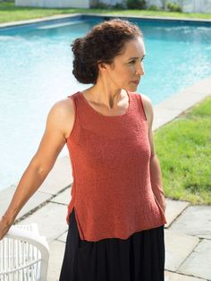 An eye-catching yet easy to work lace pattern forms a trellis up the back of this simple knitted sleeveless tee. The front is knit solid. Lace pattern is charted.