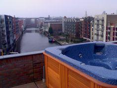 Spa met uitkijk over de grachten van Amsterdam