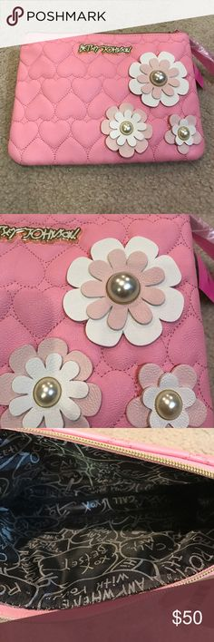 "Gorgeous Betsey Johnson pink pearl clutch Beautiful Betsey Johnson pink pearl clutch/pouch. Measures 11"" long x 8"" wide. Stunning flower cutouts with pearls inside. No Trades. Betsey Johnson Bags Clutches & Wristlets"