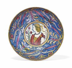 AN UMBRIAN MAIOLICA GOLD AND RUBY-LUSTRE FOOTED DISH  CIRCA 1510-20, DERUTA OR GUBBIO.