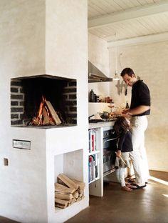 A fireplace in the kitchen should probably be associated with some sort of pizza/bread oven, no? But this looks great.