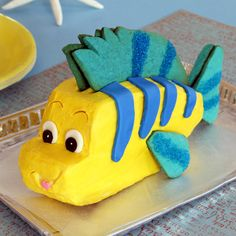 Inspired by Ariel's colorful little sidekick, this playful Flounder cake features sugar-striped cookie fins that are fun for young helpers to cut out and decorate. It's the perfect size for a small gathering of Little Mermaid fans.