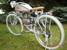 HoughMade Cycle Works 71:  Here's an interesting project that takes little money, isn't too hard to do and actually has a practical side, it's a Huffy bicycle found at a flea market, a couple of vintage looking pieces found on eBay, a new Honda 50cc engine and a few other modifications to make it look like an early grey Harley Davidson.    According to the builder it gets about 120 mpg and cruises at a comfortable 25 to 30 mph with a top speed approaching 40 mph.