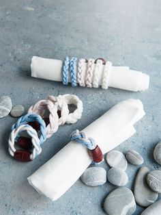 DIY weaved napkin rings are finished off with wooden pearls.