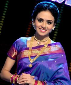 "Amruta Khanvilkar(अमृता खानविलकर) is an Indian film actress who appears in Bollywood and Marathi movies.She was seen performing lavani ""Wajle ki Bara"" in the film Natarang and Fakt Ladh Mhana.She was also a leading lady of the Marathi Films Arjun and Zhakkas. She was performed the role of a teacher in the film Shala which has got the National Award as Best Marathi Film(2012)."