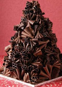 Chocolate ruffle wedding cake (Would like to see how they cut this one!) Visit http://www.brides-book.com for more great wedding resources