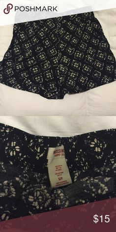 Flowy shorts Fits size small. Black shorts with white floral pattern on top. Shorts