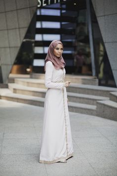 Faizah elegantly draped;Love To Dress; near the Pavilion in Kuala Lumpur, Malaysia. If you remember I posted a snap I snagged of Wak Doyok in this same locations some months ago during a visit to Malaysia. Great spot for photos! By: Langston Kuala Lumpur, Malaysia