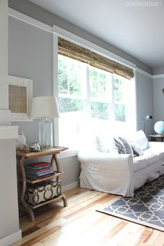 I love the cream and white and tans in this room.  Goes great with the grey walls and I think its a good way to balance the contemporary and western that I'm trying to do.