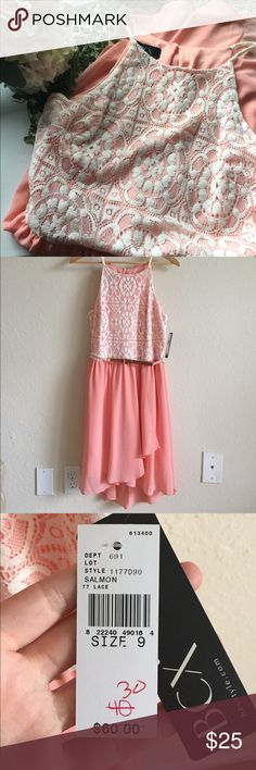 """NWT Salmon/Cream Lace Top Dress NWT Perfect spring dress! Salmon colored flow bottom with layered front. Top is cream/white lace overlaying the salmon. Slightly longer in the back. Comes with a braided belt that can be used or taken off for different looks. Bought as a backup for a bridal shower but didn't end up needing it. Inner lining is 35"""" from shoulder to hem but the outer sheer layers are longer by a few inches. BCX Dresses Midi"""
