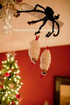 Another way to hang your Elf on the Shelf.