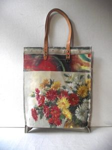 carry bags made by hand using vintage oil paintings