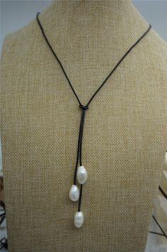 A personal favorite from my Etsy shop https://www.etsy.com/listing/228011987/freshwater-pearl-and-leather-lariat
