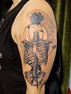 Graphic style skeleton ribcage tattoo by Xoïl