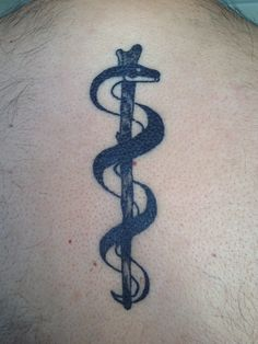 """Rod of asclepius tattoo in my upperback."" My husband's first tattoo. I'm so happy I'm finally married to an inked man. =) #jk"