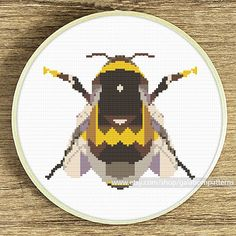 Tittle: Geometric bee Joint project with villavera.etsy.com (based on geometric artwork of villavera)  This PDF counted cross stitch pattern