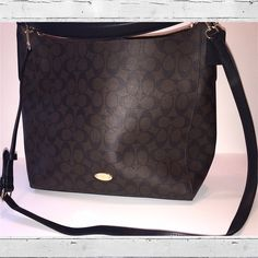 Coach Bag Brown/Black New Coach signature print convertible hobo in black/brown.  Coated canvas material (holds up really well).  Carry by the handle strap or use the optional shoulder strap.  I personally like it as a cross-body best!  1 zipper pocket and 2 open pockets on the inside.  Gold accents.  Please comment if you have any questions!  Offers may be considered Coach Bags