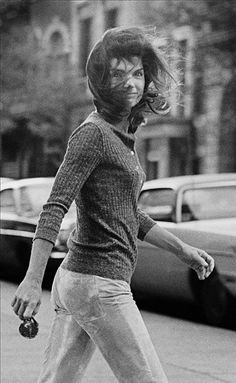 """Galella was in a New York City taxi when he spotted Jacqueline Onassis on Madison Avenue on October 7, 1971. The taxi driver blew his horn and the former first lady turned toward the sound with a half smile, the wind blowing her hair across her face. """"I call it my Mona Lisa,"""" says Galella."""