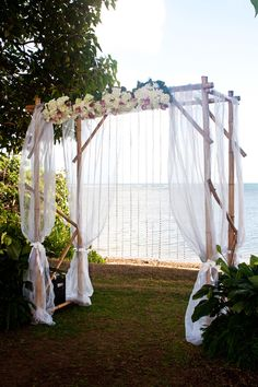 Bamboo chuppah with white chiffon fabric, flowers and crystal garlands. Flowers by The blooming Pot. Garlands from Tori Rogers. Chuppah from The Bayer Estate, where the wedding took place. Photo by Michelle Scotti.