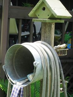 Cute way to store hose and other outdoor items.