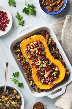 Stuffed Butternut Squash with Quinoa Salad   picklesnhoney.com // This is substantial enough to act as an entree, but can be served sliced as a side. Roasted squash, a warm quinoa salad, nutty pecans, and the brightness of parsley and pomegranate check all the fall boxes. (Vegan, Gluten-Free)
