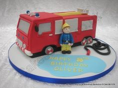 Fireman Sam Cake with Jupiter. Out on a shout. A fireman Sam fire engine shaped novelty cake Jupiter with all the bells and whistles. A sugar modelled fireman Sam is taking a breather from his fire fighting duties. A perfect cake for any little boys birthday