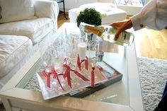 Holiday ribbon tied to champagne flutes.