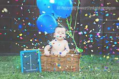 First birthday picture with fun paper confetti. Mom and brother stood on ladders next to him and threw it.