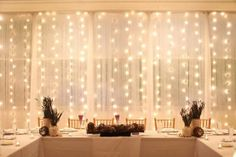 twinkle lights behind a mesh like fabric! Putting this in front of windows or even a plain wall can give your guests a wonderful view that will look great in photos!