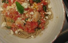 Angel hair pasta w/ shrimp, tomatoes basil, feta... One of my FAVORITE recipes.. I add a little chicken broth and the juice of one lemon to the sauce! Tastes great with fresh spinach on top at the end too :)