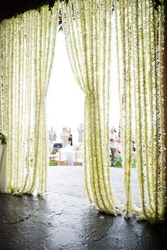 Flower strand curtain. #wedding #indian #decor