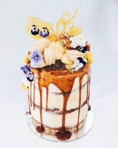 Layers of flourless red velvet, vanilla bean & honeycomb cake dripping with salted caramel & pistachio toffee