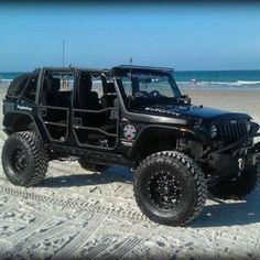 Black jeep wrangler rubicon unlimited.