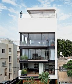 Tall and surprisingly open, the Tel Aviv Town House by Pitsou Kedem Architects continues in the tradition of its Bauhaus-inspired neighbo...