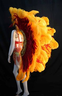 Ostrich with Coque Feathers Backpiece Style: Andromeda Wings Feather Color:Yellow Gold Ostrich with Red Coque Feathers