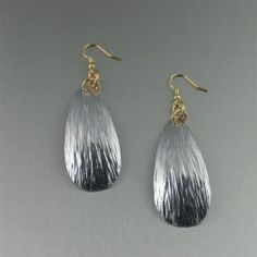 You don't need a special occasion to sparkle with these beautiful radiant Bark texture of these light weight #Aluminum Tear Drop #earrings. It's the pair you'll love to wear--with the coordinating cardigan or with whatever else is in your closet. Think of them for when you're hosting a holiday party or heading out on the town, or when you simply want to dazzle for no reason at all. $45