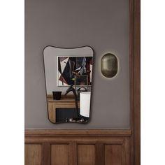 Gubi's small F.A. 33 mirror in black brass