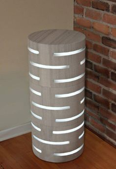 """indoor outdoor piece is sculptural and functional + both a light and a mini table!"""" Lumitonic http://www.lumitonic.com -"""