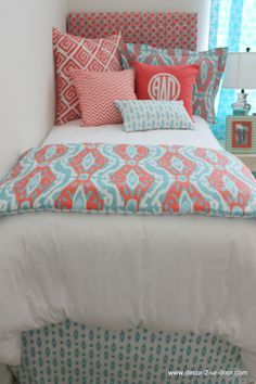 Coral and aqua bedding set. Designer headboard, custom pillows, exclusive bed scarf, window panels, wall art, bed skirts, twin XL duvet and custom monogramming!! Turn your room from drab to fab!! Monogrammed pillow HOT!