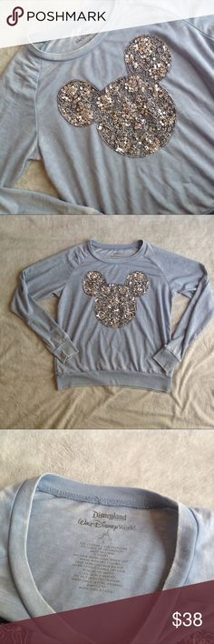 Mickey Mouse Floral Embellished Sweatshirt Disney Excellent used condition. Lightweight sweatshirt with large Mickey Mouse silhouette across the front, embellished w/ silver sequins & jewels in a floral print. By Disneyland Resort & Walt Disney World. Soft blue gray shirt with manufacturer intended fading/distressing. Perfect for a winter Disney trip! Note: very small hole from store tag at collar, see photos. Size L, see photos for measurements. Disney Tops Sweatshirts & Hoodies