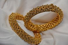 Glitter with this pair of bangles in gold plating. Perfect for the night out, or a special date night. Size: (Has a screw) Includes: Gold-plated. SHIPPING: Included in price for Continental U. Bangles, Bracelets, Diamond Jewelry, Solid Gold, Night Out, Fashion Jewelry, Artisan, Collection, Diamond Jewellery