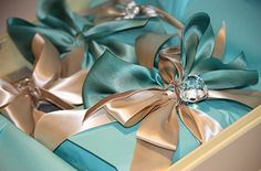 Gift wrap gorgeous champagne and turquoise ribbon together