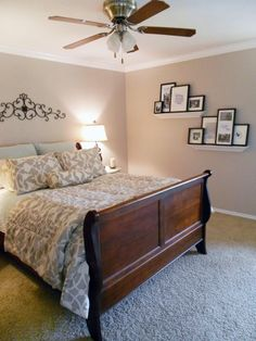 Serene bedroom with staggered floating shelves for art and photos
